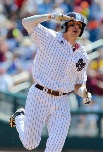 Mississippi State's Hunter Renfroe salutes as he rounds the bases after hitting a three-run home run against Oregon State in the fifth inning of an NCAA College World Series baseball game in Omaha, Neb., Friday, June 21, 2013. (AP Photo/Eric Francis)
